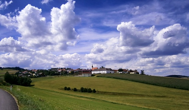 austria, landscape, scenic, hill, fields, village, sky
