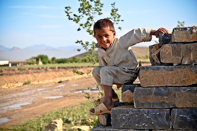 boy, climbing, stone wall, village, playful