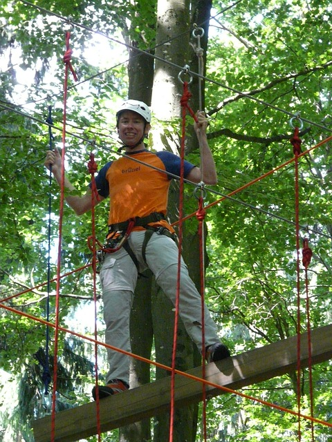 high ropes course, man, person, rappel to, backed up