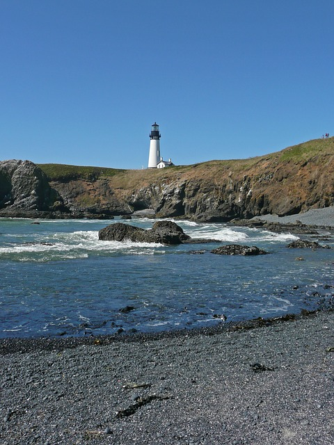 pebble beach, lighthouse, building, maritime, beach