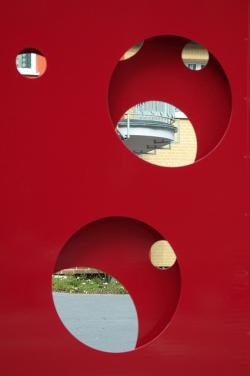 by looking, goal, hole, circle, red, metal, about