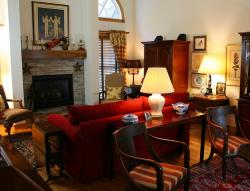 chairs, tables, sofa, couch, fireplace, rugs, room
