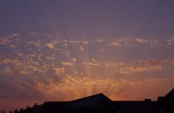 evening sky, afterglow, sunset, sunbeam, roofs, clouds