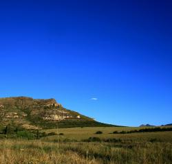 hill, slope, grass, green, earthy, rocky, very blue sky