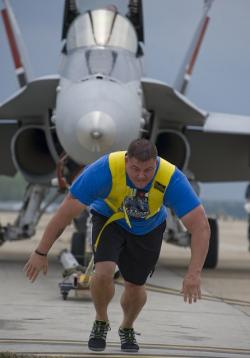 jet fighter, aircraft, man, pulling plane, big, large