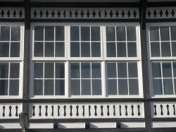 windows, old mansion type, barred, white, black, fancy